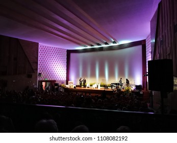 Benevento, Campania, Italy - 7 June 2018: Mayor Clemente Mastella on the stage of the San Marco Cinema while introducing the presenter Gigi Marzullo who in turn will present the 12 authors nominated f