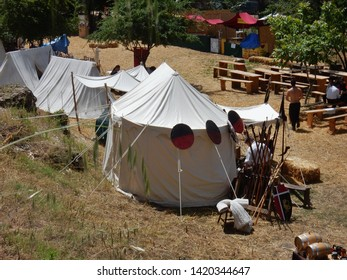 """Benevento, Campania, Italy - 9 June 2019: Historical re-enactment of a Longobard village in the archaeological area of the Saints Quaranta during the eighth edition of the """"La Contesa di Sant'Eliano"""""""