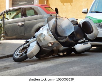 Benevento, Campania, Italy - April 5th 2017: Scooters parked just fell off the stand for pushing the rear of the car received