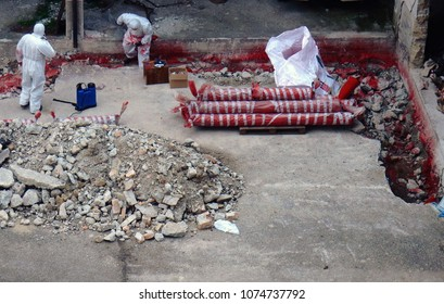Benevento, Campania, Italy - February 23, 2016: Operations of reclamation of a site from asbestos pipes