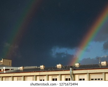 Benevento, Campania, Italy - November 26, 2018: Double rainbow after a short thunderstorm. The dark area between the two arches is called Alexander's Band