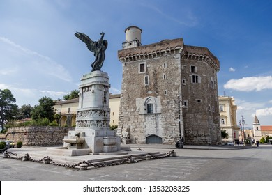 """Benevento, Campania, Italy - October, 2018 - The War Memorial Monument built in 1929 by King Vittorio Emmanuele III, located in """"Piazza IV Novembre"""", Rectors palace on background, Benevento, Italy"""