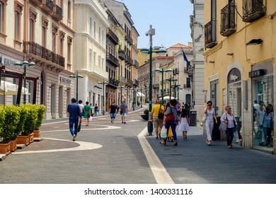 Benevento, Campania/Italy - 07 21 2018: People are walking on Corso Garibaldi in Benevento, the main street and the heart of the city.