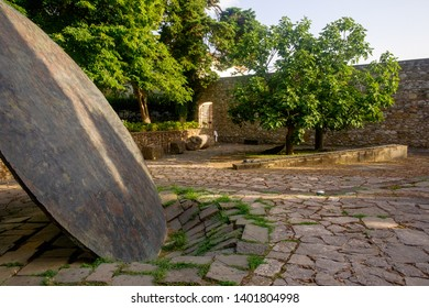 Benevento, Campania/Italy - 07 21 2018: The 'Hortus Conclusus' is a garden of a former monastery in Benevento and has works of art of contemporary artist Mimmo Paladino. 'The Disk' is one of them.