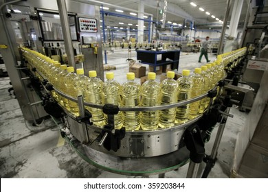 BENEVENTO, ITALY - 12 NOVEMBER 2012: Bottles of olive oil travelling along the production line inside a factory for the production of edible oils.