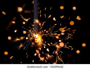 Bengal fire sparks on black background. Celebratory background. New Year's and Christmas