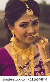 Bengali bride in bridal dress and jewelry smiling and posing for photo indian lifestyle
