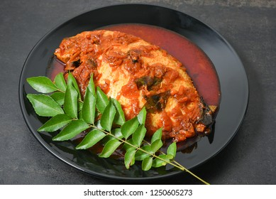 Bengali fish curry, Telapia Sorshe Jhal or Macher Jhal is a hot and spicy seafood of Kolkata, West Bengal in  India. fish cooked in mustard sauce with  yellow mustard seeds, garlic, onion, tomato.