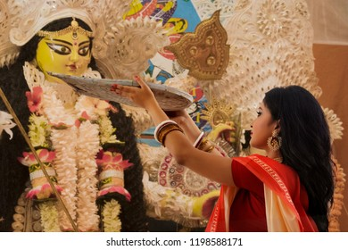 Bengali Married Woman worshipping godess durga with Bamboo Tray