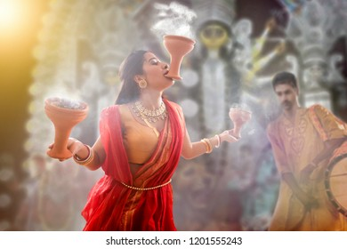 Bengali Married women performing dhunuchi dance on the occasion of Durga puja