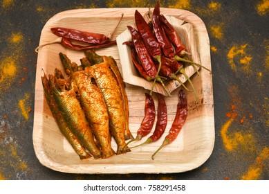 Bengali Sardine or pilchard fry fish curry with salad tasty sea food cuisine, Kerala India. Popular dish in Indian coastal area restaurants Kochi, Goa.