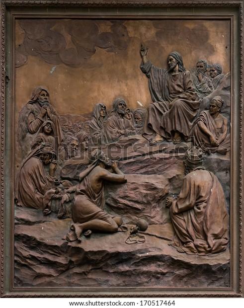 BENGALURU, INDIA - CIRCA NOVEMBER 2013: Bas-relief of Jesus preaching on the mount at Saint Mary's Basilica in Bengaluru.