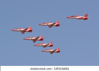 Bengaluru, India - Feb 23, 2019: Surya Kiran aerobatics team of the Indian Air Force flying at Aero India 2019. Aero India is a biennial air show and aviation exhibition.