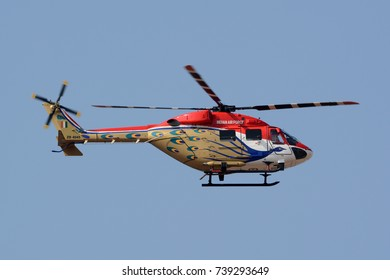 BENGALURU, INDIA - FEBRUARY 15, 2017: An HAL Dhruv of the Indian Air Force's Sarang Helicopter Display Team at Aero India 2017. Aero India is a biennial air show and aviation exhibition.