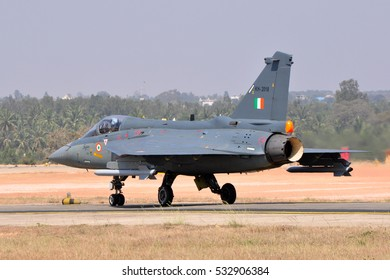 BENGALURU, INDIA - FEBRUARY 22, 2015: HAL Tejas of Indian Air Force on the tarmac at Aero India 2015. Aero India is a biennial air show and aviation exhibition.