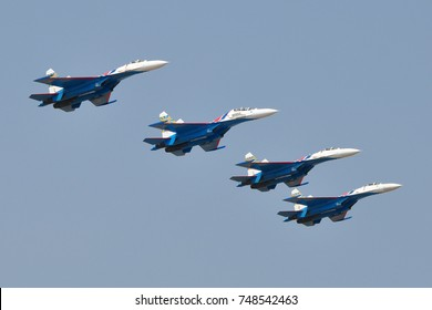 BENGALURU, INDIA - FEBRUARY 9, 2013: The Russian Knights is an aerobatic demonstration team of the Russian Air Force at Aero India 2013. Aero India is a biennial air show and aviation exhibition.