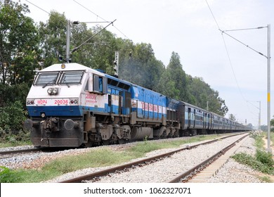 Bengaluru, India - November 29, 2014: A  passenger train of the Indian Railways being hauled by a diesel locomotive.