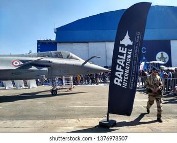BENGALURU, KARNATAKA, INDIA, FEBRUARY 23, 2019: Aero India 2019. Visitors watching the French Dassault Rafale fighter aircraft displayed on the airshow ground.