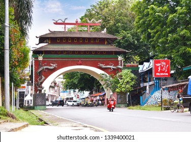 Bengkulu, Indonesia - March 06, 2019: Red china dragon gate in Bengkulu city Sumatra Indonesia.