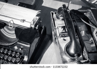 BENICASIM - SEPTEMBER 2018: Telephone and typewriter of the 1940 World War in a historical recreation.