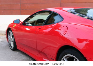 BENICASIM, SPAIN - 2016: Ferrari F430 on the street park in front of a big house.