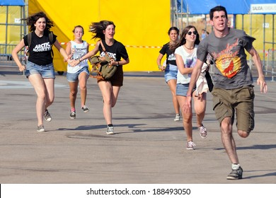 BENICASIM, SPAIN - JULY 19: People run to catch the first row after buying their tickets at FIB Festival on July 19, 2013 in Benicasim, Spain. FIB is the Spanish Coachella festival.