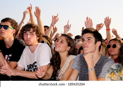 BENICASIM, SPAIN - JULY 19: People (fans) watch a concert of their favorite band at FIB (Festival Internacional de Benicassim) 2013 Festival on July 19, 2013 in Benicasim, Spain.