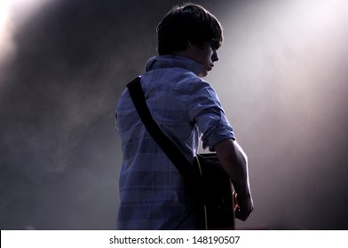 BENICASIM, SPAIN - JULY 21: Jake Bugg band concert performance at FIB (Festival Internacional de Benicassim) 2013 Festival on July  21, 2013 in Benicasim, Spain.