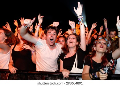 BENICASSIM, SPAIN - JUL 16: People from the audience what a concert at FIB Festival on July 16, 2015 in Benicassim, Spain.