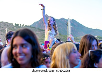 BENICASSIM, SPAIN - JUL 17: The crowd in a concert at FIB Festival on July 17, 2016 in Benicassim, Spain.