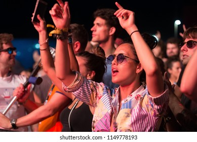 BENICASSIM, SPAIN - JUL 21: The crowd in a concert at FIB Festival on July 21, 2018 in Benicassim, Spain.