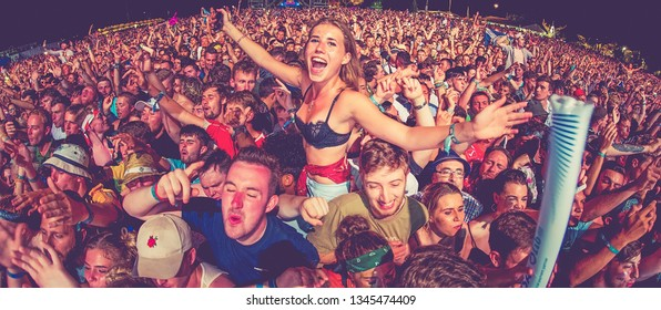 BENICASSIM, SPAIN - JUL 22: The crowd in a concert at FIB Festival on July 22, 2018 in Benicassim, Spain.