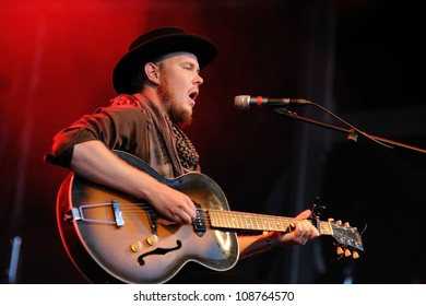BENICASSIM, SPAIN - JULY 13: Taylor Kirk, lead singer and guitarist of Timber Timbre, performs at FIB on July 13, 2012 in Benicassim, Spain. Festival Internacional de Benicassim.