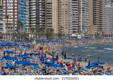 Benidorm. Spain. 04.17.17. Crowds of Holidaymakers on the main beach in Benidorm, Spain.  A city in the province of Alicante on the Costa Blanca in eastern Spain, on the Mediterranean coast.