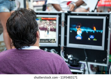 Benidorm, Spain, 07/26/2018; Videographer at the console is reporting from the city holiday. Video editor at work.