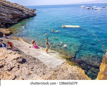 Benidorm, Spain; 11-11-2018: Beach on the island of Benidorm, Spain. Tourists bathing in crystal clear water and bathing area.
