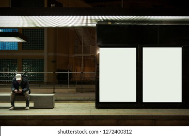 Benidorm, Spain, 12/17/2018: A man is waiting for a tram at the bus stop. Tram stop at night. Place for text. Bus stop. Urban transport. Mock up. Mockup.