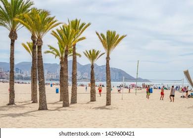 Benidorm, Spain, 16 June, 2019: People enjoying sunny day on Benidorm beach. Healthy lifestyle