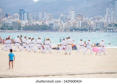 Benidorm, Spain, 16 June, 2019: Active people group doing training exercises on the beach in Benidorm. Healthy lifestyle