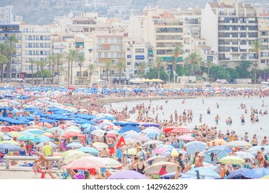 Benidorm, Spain, 16 June, 2019: View of Benidorm Poniente beach full of resting people in Benidorm, Spain