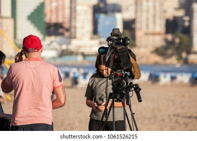 Benidorm, Spain, 28/03/2018: Camcorder on the tripod. The operator and the announcer are preparing the airtime on the Levante beach.