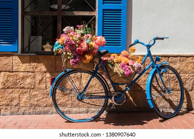 Benidorm, Spain - April 13th 2019: A beautifully decorated bicycle in the old town area of Benidorm in Spain.