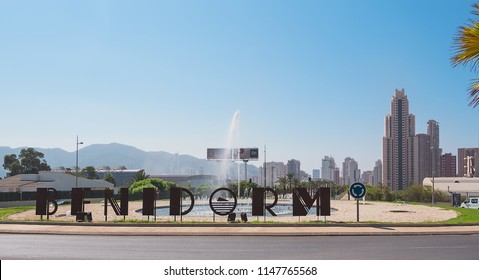 Benidorm, Spain, August 1, 2018. roundabout, entrance sign to Benidorm and view of the buildings and skyscrapers of the city of the Spanish white coast