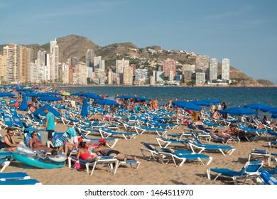 Benidorm, Spain, circa september 2018: People on the beach in Benidorm, Spain