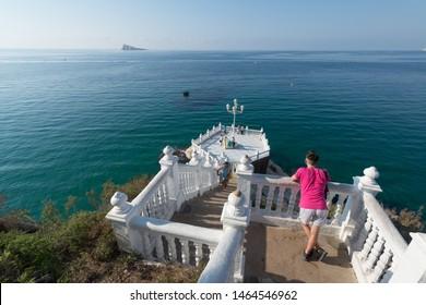 Benidorm, Spain, circa september 2019: Benidorm balcon del Mediterraneo with tourists and sea from white balustrade Alicante Spain