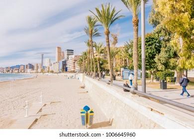 Benidorm, Spain - January 14, 2018: Benidorm Poniente beach and promenade, Benidorm, Costa Blanca, Spain.