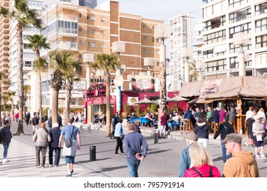 Benidorm, Spain - January 14, 2018: People walking on the embankment street in Benidorm, Spain.