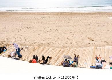 Benidorm, Spain - January 29, 2018: People enjoying winter holiday in Benidorm, Spain.