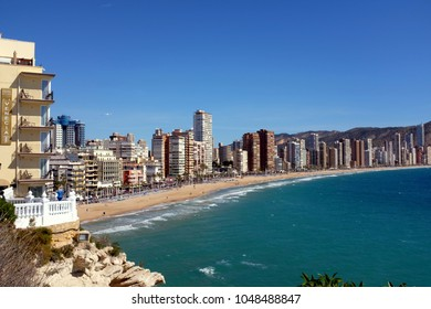Benidorm, Spain.  March 07, 2018. Taken from the Point of holidaymakers enjoying the beach and Promenade of Levante beach and the Avenue d'Alcoi Promenade at Benidorm on the Costa Blanca in Spain.
