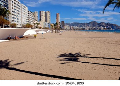 Benidorm, Spain. March 09, 2018.  Holidaymakers relaxing and playing in the March sunshine on Poniente beach in Benidorm on the Costa Blanca in Spain.